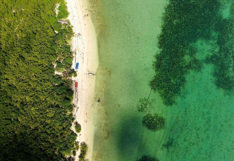 A Lagoon with a Coral Reef and a White Sandy Beach, Aerial Drone. Caramoan Islands, Philippines